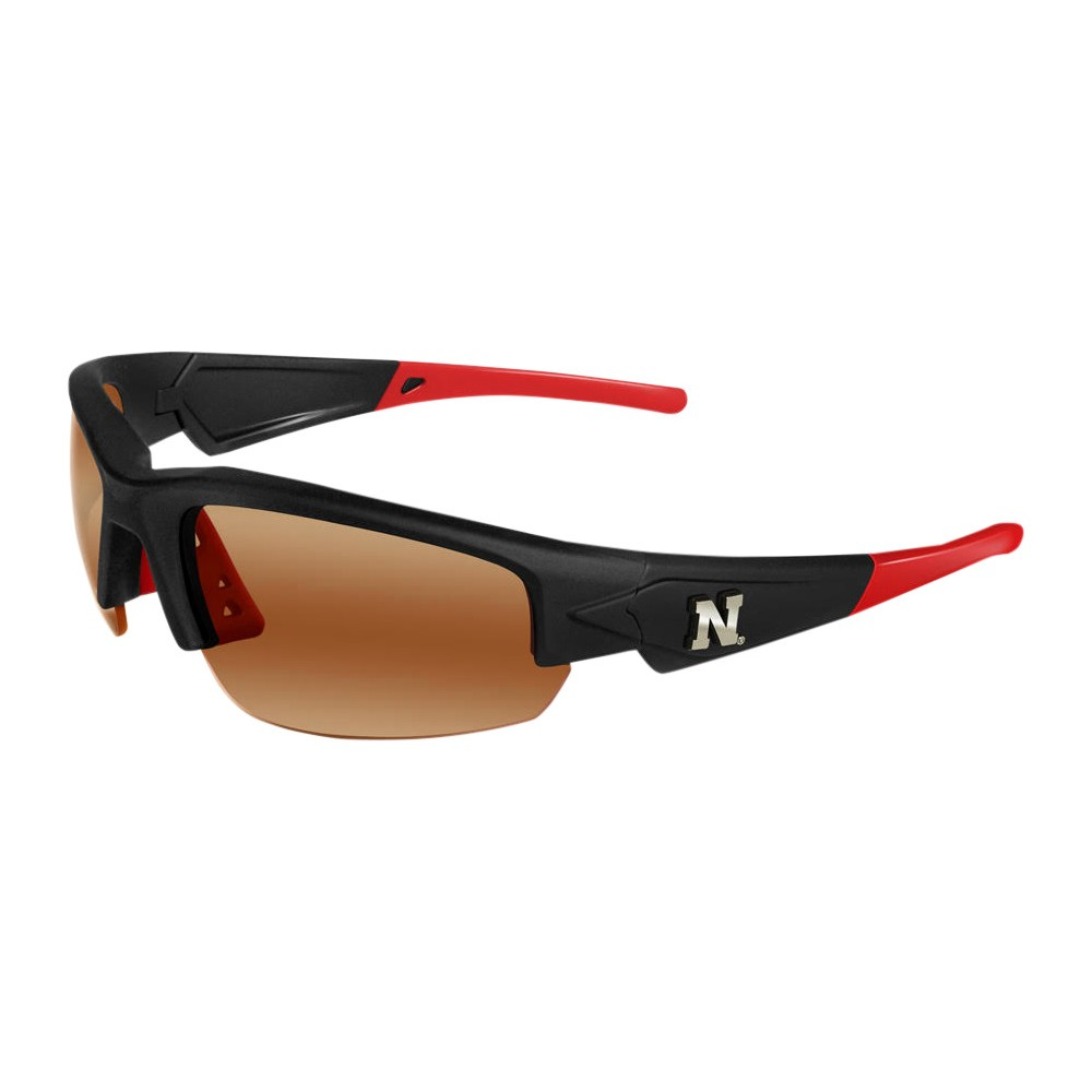 Nebraska Cornhuskers Dynasty 2.0 Sunglasses, Adult Unisex The Nebraska Cornhuskers Dynasty 2.0 is a sports frame sunglass for men and women of all ages. This sleek sunglass features Black Frame with Team Colored Tips and a HD Polarized lens. Raised metal Nebraska Cornhuskers logos on each temple round out this Team first sunglass while allowing no peripheral distortion for all outdoor activities. Gender: Unisex. Age Group: Adult. Pattern: Solid.