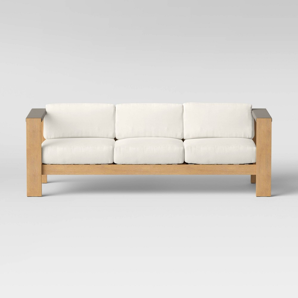 Extending your patio setup with the Montpelier Wood Patio Sofa from Project 62?. Building in good shape with sturdy Eucalyptus wood in rustic style coating and durable Sunbrella cushion in clean look, this patio sofa is a reliable choice in terms of both quality and aesthetics. Accent your existing patio space with this beautiful lounge piece and liven up with some decor pillows or throw, lounge in and relax! Gender: unisex.