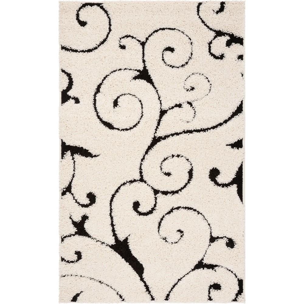 6'X9' Swirl Loomed Area Rug Ivory/Black - Safavieh