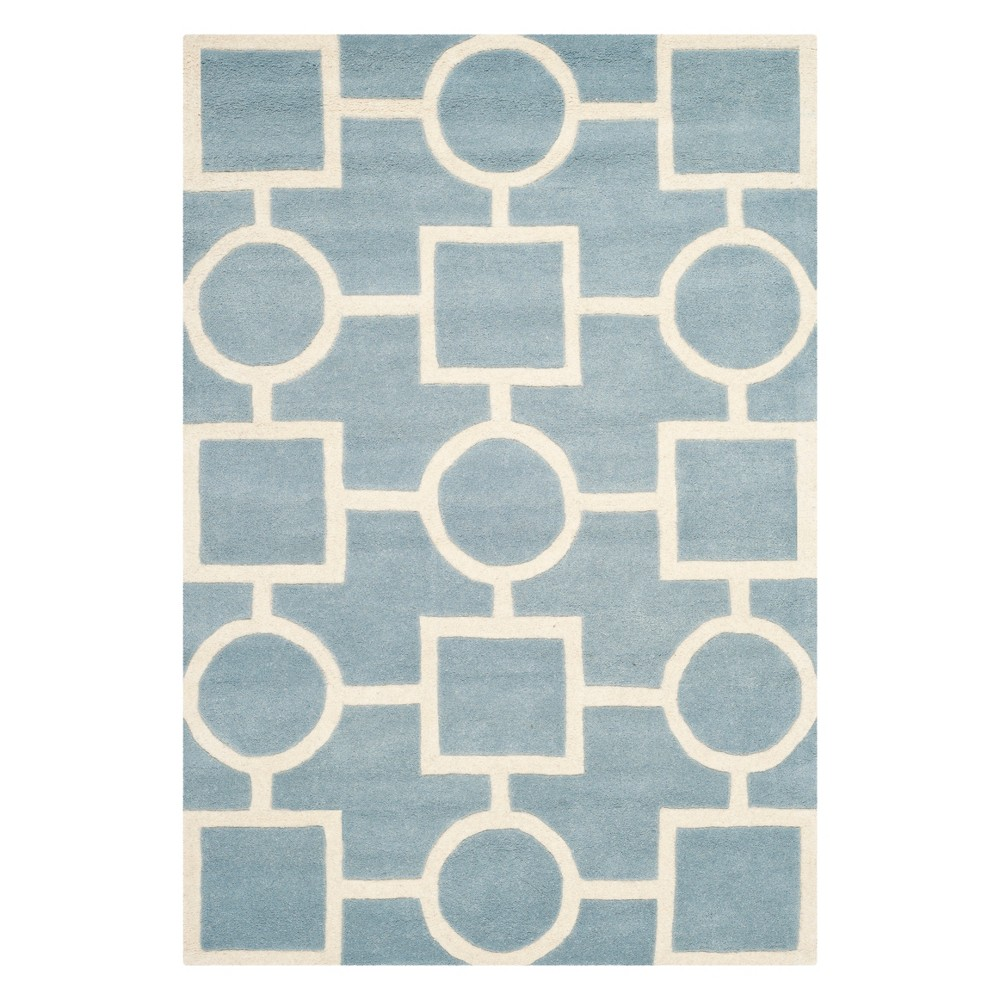 5'X8' Geometric Tufted Area Rug Blue/Ivory - Safavieh
