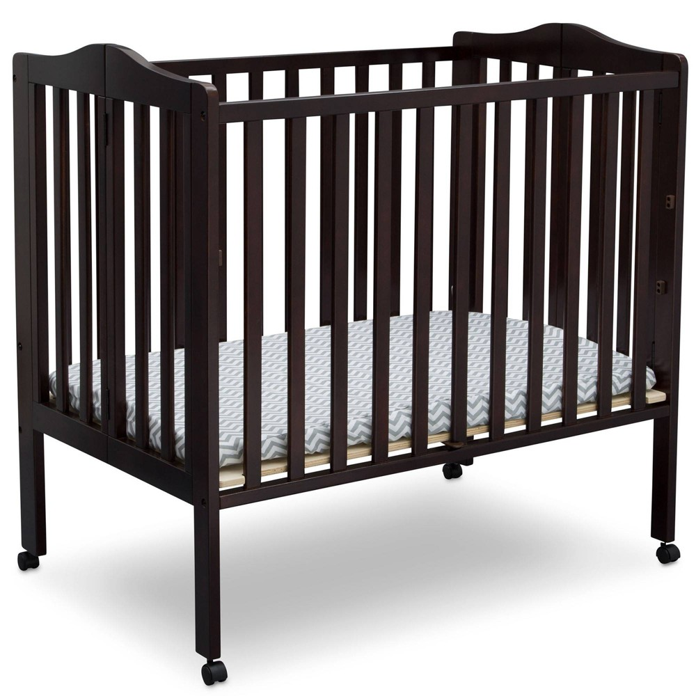 Image of Delta Children Folding Portable Mini Baby Crib with Mattress - Dark Chocolate