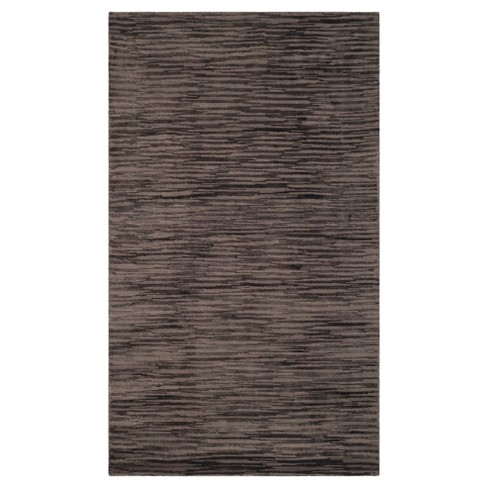 Amani Solid Woven Rug - Safavieh - image 1 of 3