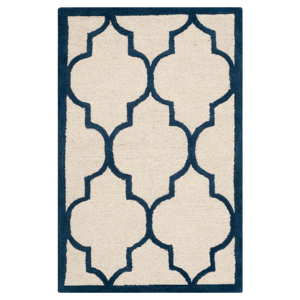 2'X3' Geometric Accent Rug Ivory/Navy (Ivory/Blue) - Safavieh