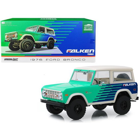 "1976 Ford Bronco Green and Blue with Cream Top ""Falken Tires"" 1/18 Diecast Model Car by Greenlight - image 1 of 4"