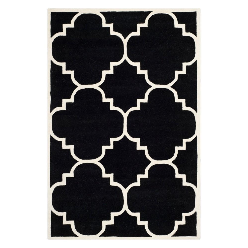 6'X9' Quatrefoil Design Tufted Area Rug Black/Ivory - Safavieh