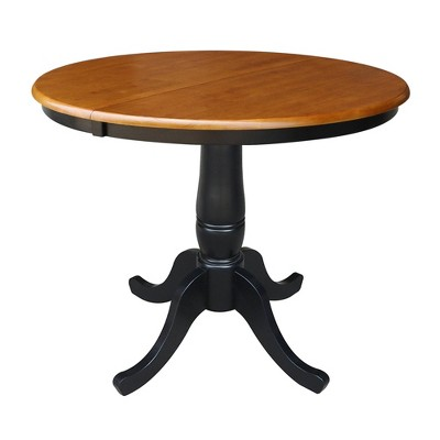 """36"""" Round Top Pedestal Extendable Dining Table with 12"""" Drop Leaf Black/Red - International Concepts"""