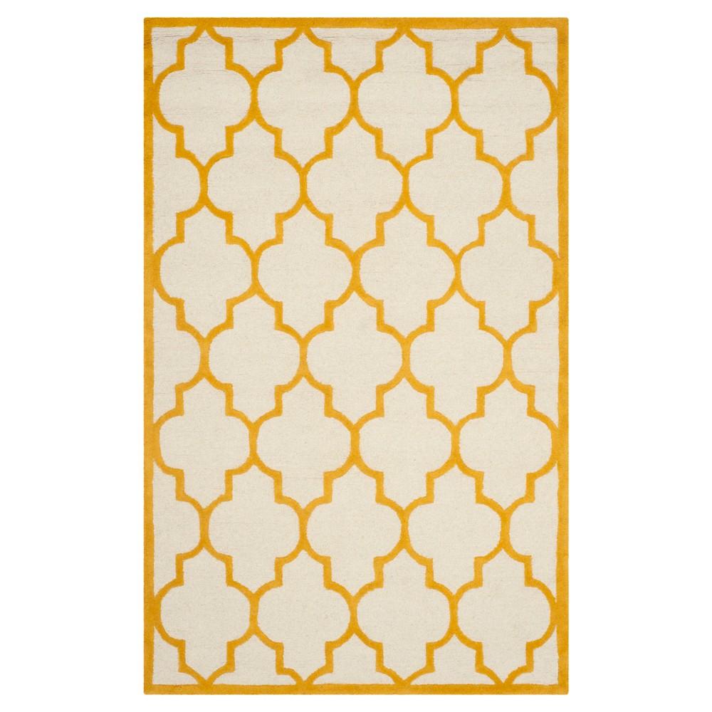 5'X8' Geometric Area Rug Ivory/Gold - Safavieh