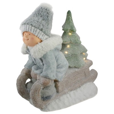 "Northlight 15"" Beige and Green Lighted Boy on a Sled Christmas Decoration"