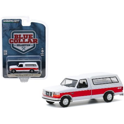 """1994 Ford F-150 XLT 4x4 Pickup Truck with Camper Shell White with Red Stripe """"Blue Collar Collection"""" Series 7 1/64 Diecast Model Car by Greenlight"""