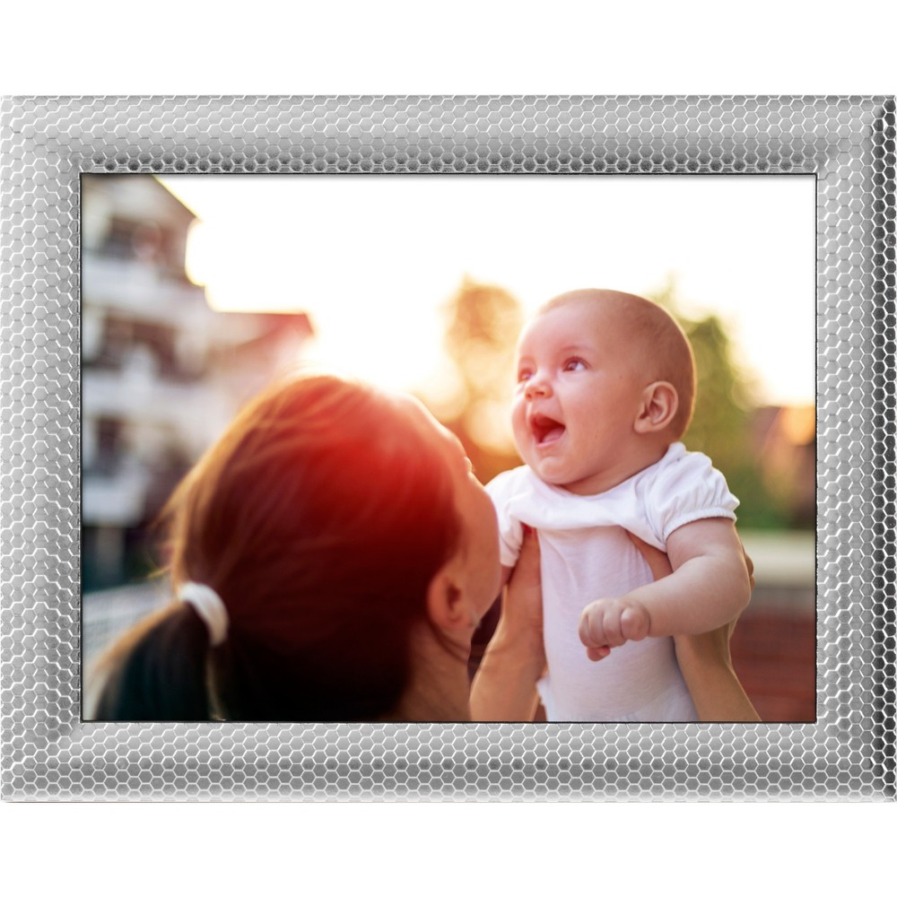 8 WiFi Digital Frame Silver - Polaroid Display all your favorite photos using one frame when you add this Wi-Fi Digital Frame from Polaroid to your decor collection. This silver digital photo frame features an eight-inch high-resolution screen that displays photos sent from your smartphone or iPad, giving you the ability to customize your display depending on what you want to see. The frame can store up to 4GB of pictures, while the Led touchscreen helps you adjust slide transitions, interval timing, image editing and more. Not to mention — the textured silver-finish metal construction with allover hexagon embossment creates an appealing accent on its own, making this digital picture frame the complete decor addition. Size: 8.