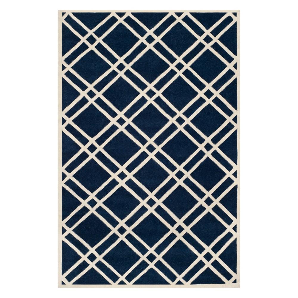 6'X9' Geometric Tufted Area Rug Dark Blue/Ivory - Safavieh