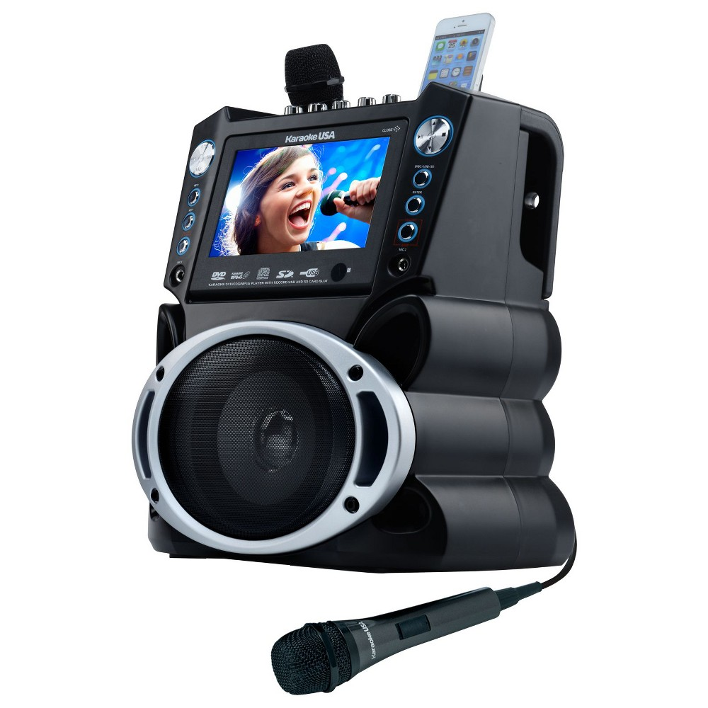 Karaoke USA Dvd/Cdg/MP3G Karaoke Machine with 7 Tft Color Screen (GF839), Black/Silver This karaoke player has a sleek design matched by no other player you'll ever find. It's features will keep any karaoke enthusiast busy. A color screen that's gorgeous and easy to read far away. Comes with 300 MP3G songs on disc, but will play any normal karaoke Cdg, Dvd Karaoke or watch a Dvd movie. Keeping in tune with the digital age, it will accept auxilary input from most any personal player and gaming console. Even has a handy cradle to rest your MP3 player in for charging or watching your screen in an upright position. Sing and record music and your voice onto an SD Card in MP3 format from your favorite karaoke disc or download, then play it back or take it with you. Audio/video outputs for connection to big screen TV, or better, your home entertainment center for great sound. Color: Black/Silver.