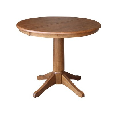 """Lillian Round Top Pedestal Table with 12"""" Drop Leaf Distressed Oak - International Concepts"""