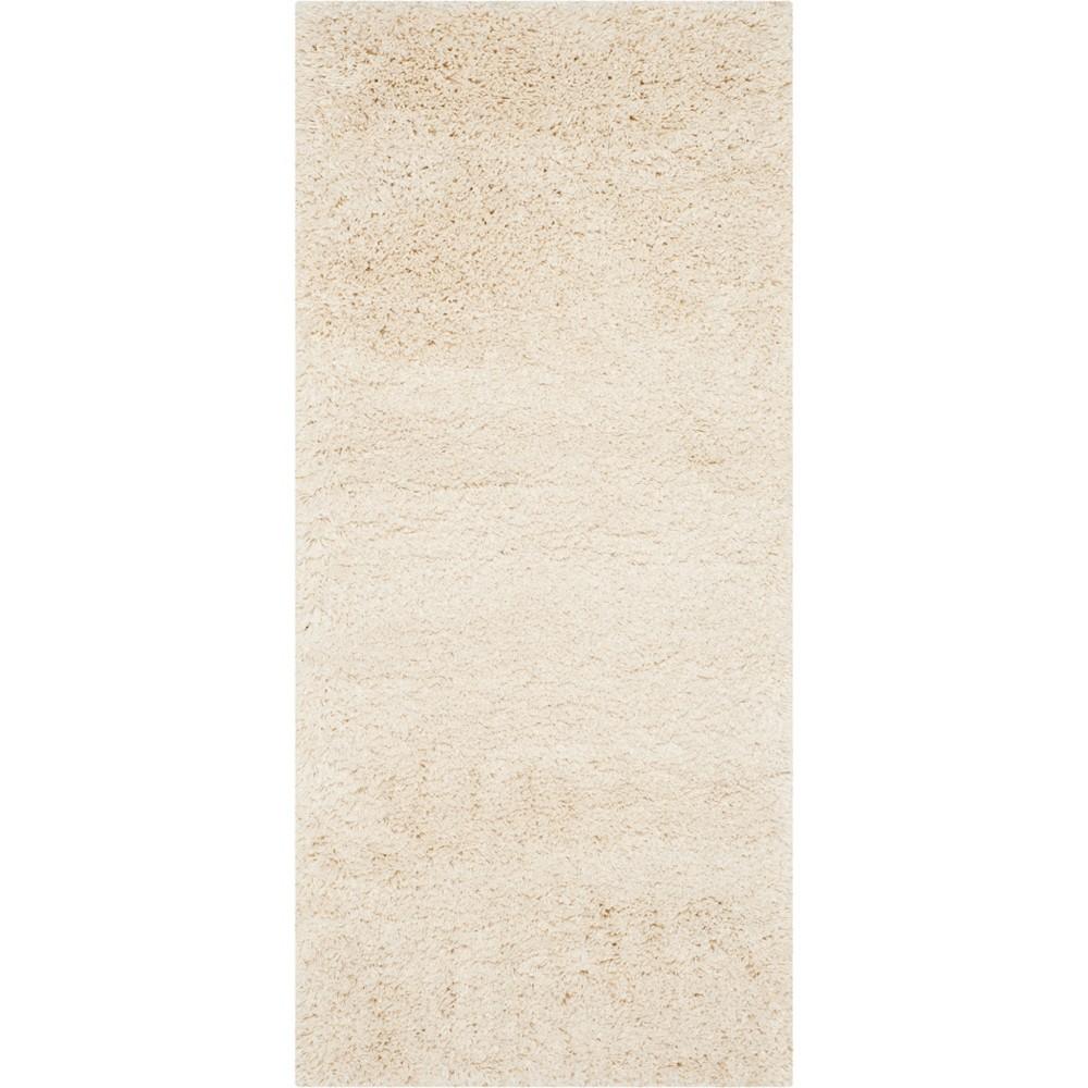 2'3X17' Solid Loomed Runner Ivory/Light Gray - Safavieh