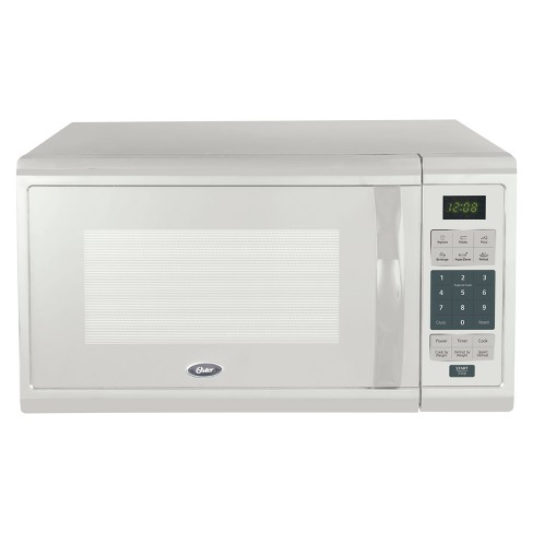 Oster 1.1 cu ft 1000W Microwave - White OGCMZJ11WE-10 - image 1 of 4