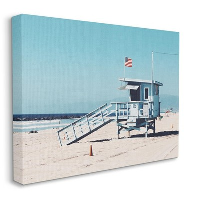 Stupell Industries Blue Lifeguard Stand at Coastline American Flag