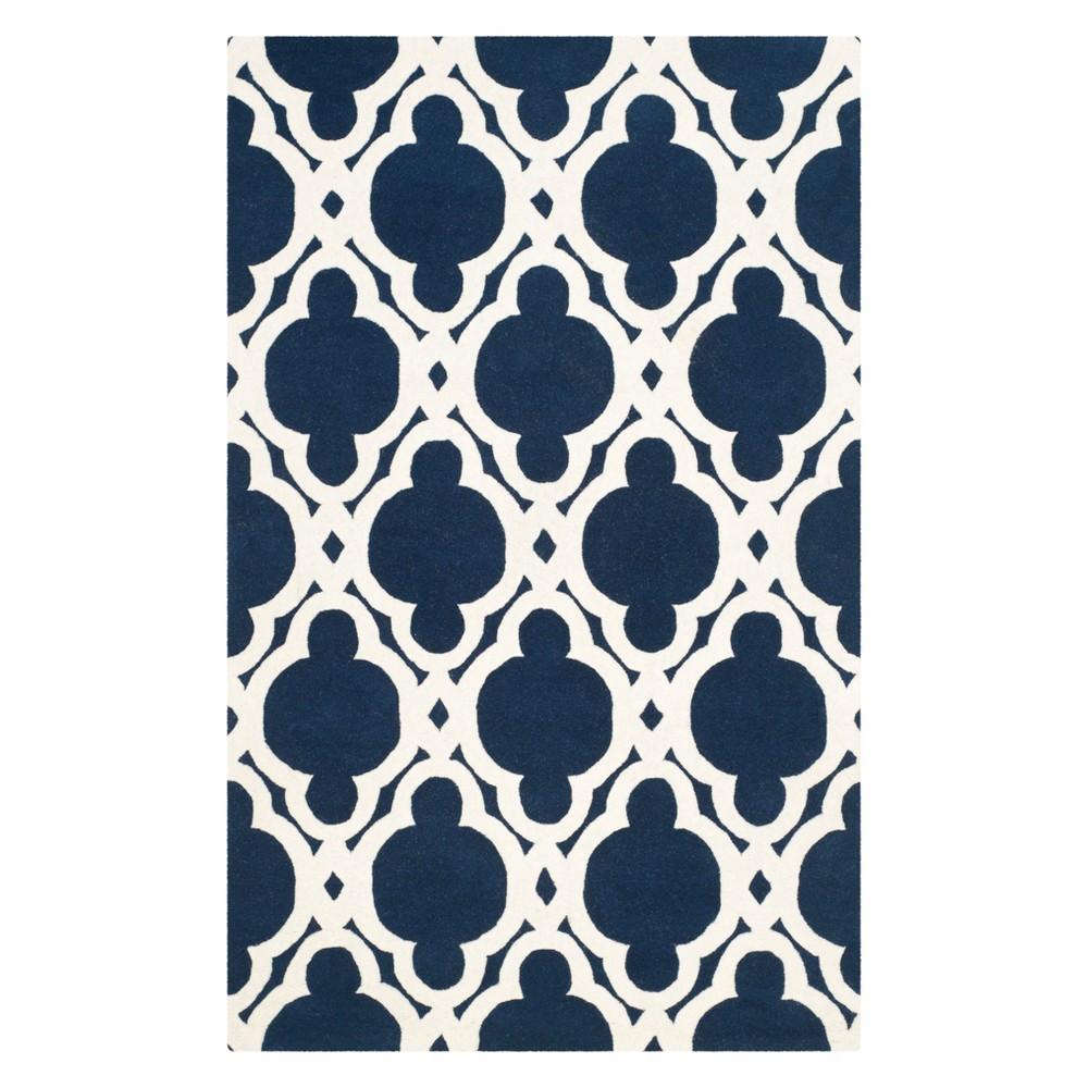 4'X6' Quatrefoil Design Tufted Area Rug Dark Blue/Ivory - Safavieh