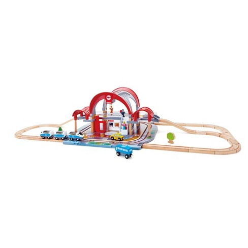 Hape Grand City Themed Magnetic Kids Play Freight Train Railway Station Toy Set with Electronic Features, Tax, and Bus - image 1 of 4