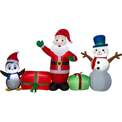 Gemmy Christmas Airblown Inflatable Santa/Snowman/Penguin Collection Scene, 5 ft Tall, Multicolored