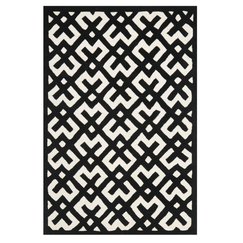 Ivory/Black Geometric Tufted Accent Rug 4'X6' - Safavieh