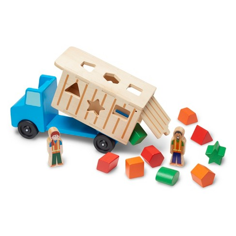 Melissa & Doug® Shape-Sorting Wooden Dump Truck Toy With 9 Colorful Shapes and 2 Play Figures - image 1 of 4