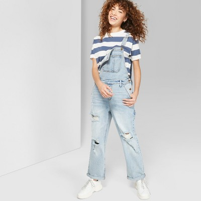 view Women's Destructed Denim Overall - Wild Fable Light Denim on target.com. Opens in a new tab.