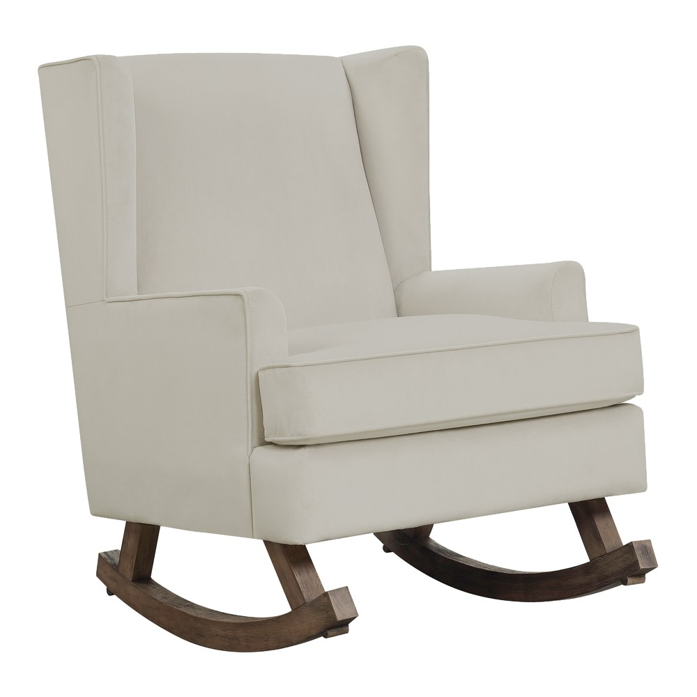 Lily Rocker White Chocolate - Picket House Furnishings The Picket House Furnishings Lily Glider Chair will rock your little one to sleep! The super soft fabric of this chair feels great to the touch and will provide comfort while you rest in this rocker. Straight edge arms and wingback design provide a sleek and contemporary look. The wooden glide base brings a modern touch to the overall look of this glider chair. Color: White Chocolate. Gender: Unisex. Pattern: Solid.