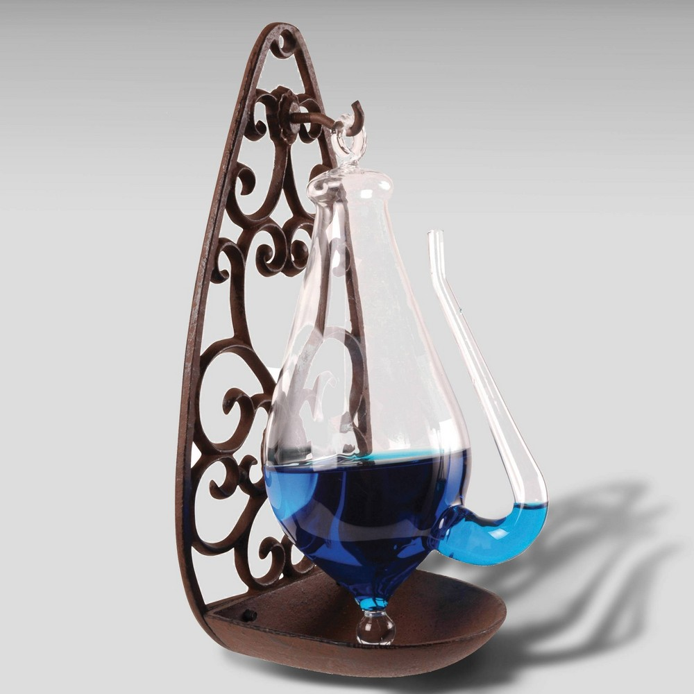 11 Weather Glass Filigree Holder Brown - Esschert Design This weather glass comes with a cast iron filagree holder.  Thunderglass  was one of the earliest type of functioning barometers. Add color to the water to make this not only a functional but a beautiful instrument. - Antique brown cast iron with glass