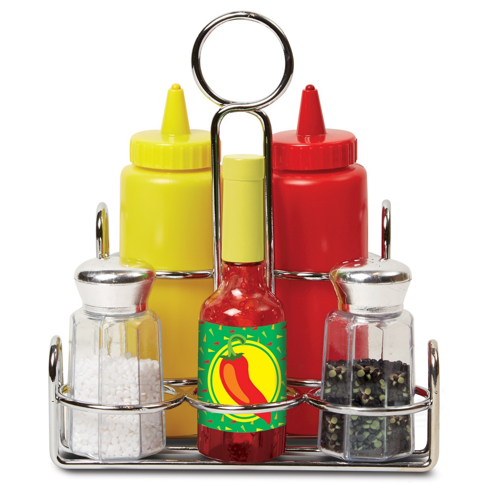 Melissa & Doug Condiments Set (6pc) - Play Food, Stainless Steel Caddy A must-have for the well-appointed play kitchen, these condiments sound and look like the real thing! Packaged in a handy metal caddy to keep everything organized, the six-piece set includes ketchup, mustard, salt, pepper, and hot sauce. Best of all: The salt and pepper really  shake,  the hot sauce really  pours,  and the ketchup and mustard  squirt  string! These wonderfully durable play pieces are built to last through countless culinary adventures. Gender: Unisex.