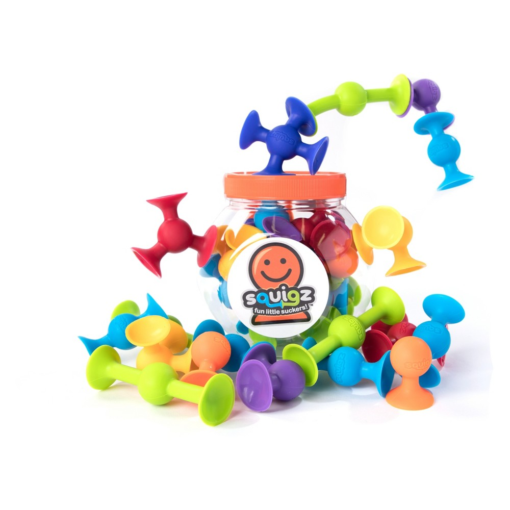 Fat Brain Toys Squigz Suction Construction Set - 18pc Design and construct with a satisfying pop with the Mini Squigz Construction Set from Fat Brain Toys. Stick these little suction pieces to any flat surface and build them up and out to create fun structures. Put them together and then pull them apart to hear that satisfying pop as you build with the various shapes and sizes. Gender: Unisex.
