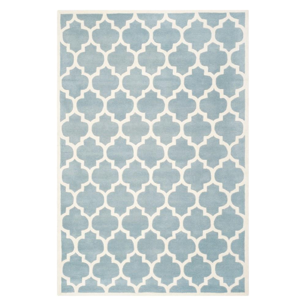 6'X9' Quatrefoil Design Tufted Area Rug Blue/Ivory - Safavieh