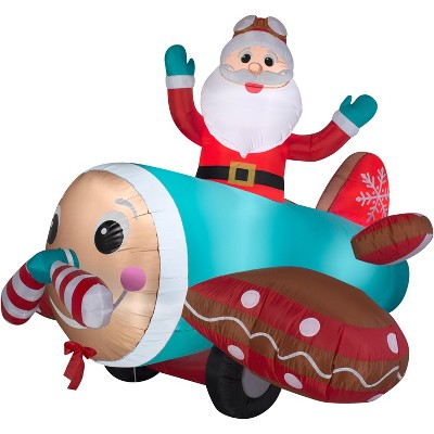 Gemmy Animated Christmas Airblown Inflatable Gingerbread Airplane, 5 ft Tall, Multicolored