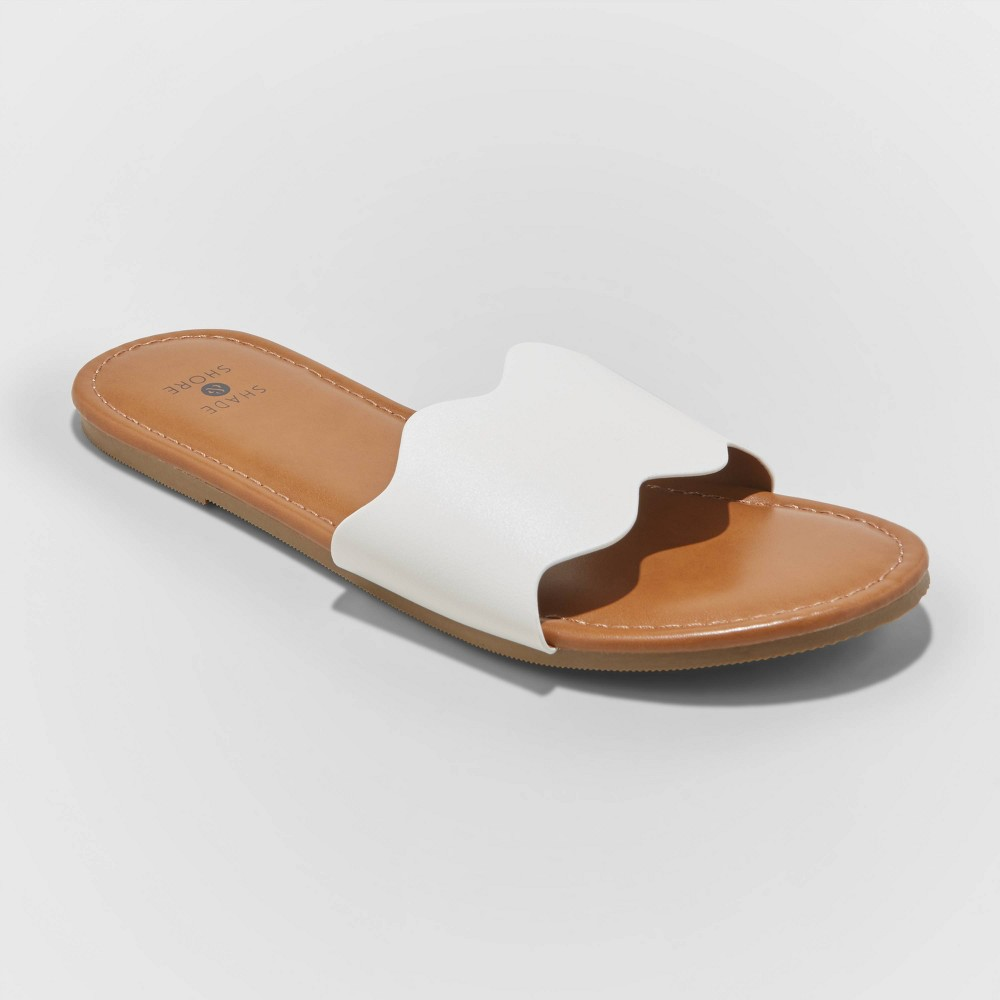 Get ready for beach days and poolside hangs with the Kate Scalloped Slide Sandals from Shade and Shore™. A faux-leather upper sole lends a sweet, laid-back look with the help of a scalloped edge, maintaining an unfettered aesthetic with its solid color. You'll love the ease of a slip-on design, as sunny days call for quick trips from the pool to the cabana — no time to deal with straps and laces! A light brown hue finishes the foot bed for a warm, neutral color you can pair with any swimsuit or cover-up for a season of comfort and style. Size: 12. Color: White. Gender: female. Age Group: adult.