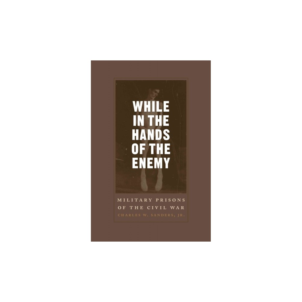 While in the Hands of the Enemy : Military Prisons of the Civil War (Reprint) (Paperback) (Jr. Charles