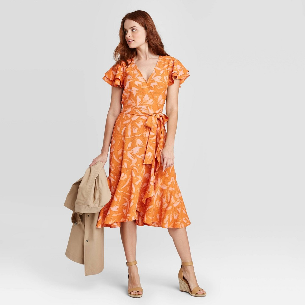 Add frilly, springtime charm to your wardrobe with the Floral-Print Ruffle Short Sleeve Wrap Dress from A New Day™. An eye-catching floral print in off-white decorates the textured background of this orange wrap dress to lend refreshing, playful vibes, and the soft fabric construction with added spandex lends you a flexible fit for all-day comfort. This printed knee-length dress features a splice neck accented with a wrap front and a sash tie to cinch your frame for a flattering silhouette, while the ruffle accents on the sleeves and hemline add flared, fluttery charm. Wear it with statement earrings and strappy heels to flaunt your look. Size: XXL. Gender: female. Age Group: adult. Material: Polyester.