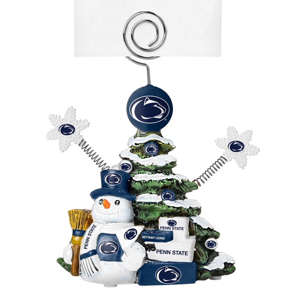 Penn State Nittany Lions Tree Photo Holder Beautifully detailed cold cast porcelain tree with snowman and presents. Decorated with colofrul team graphics, this table sop holder is great for holding photos, notes to santa or place cards. Stands 5 tall Color: Penn State Nittany Lions. Age Group: Adult.