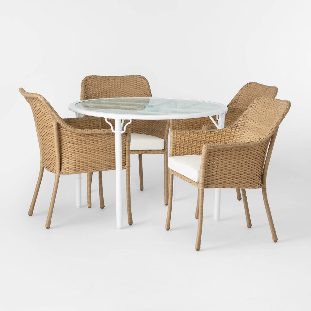 The Pomelo Mix and Match Patio Dining Set from Opalhouse™ will provide style and comfort to your outdoor hosting and entertaining space. The five-piece furniture set includes four armchairs featuring an elegant tub silhouette and woven in brown, rattan-like material for a touch of natural flair. The round table stands on a stylish, white metal frame and features tempered-glass tabletop fitted with an umbrella hole in the center to let you add a patio umbrella with ease. The white seat cushions offer a bright contrast to the brown woven frame of the chairs while providing comfort as you sit and relax, and they match with the frame of the table for a cohesive look. This is your house. Where you create spaces as bold as your spirit. Collect objects as inspired as your dreams. Find pieces that remind you of every place you've been. Discover stories to inspire everywhere you have yet to go. This is Opalhouse. Gender: unisex.
