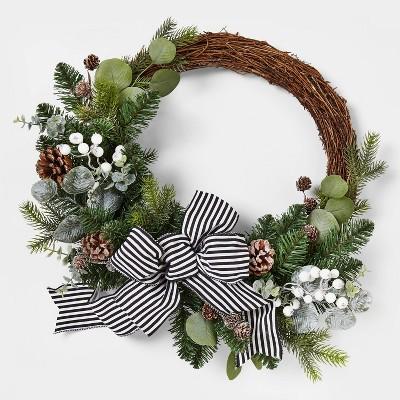 24in Unlit Asymmetrical Artificial Wreath with White Berries & Stripe Bow - Wondershop™