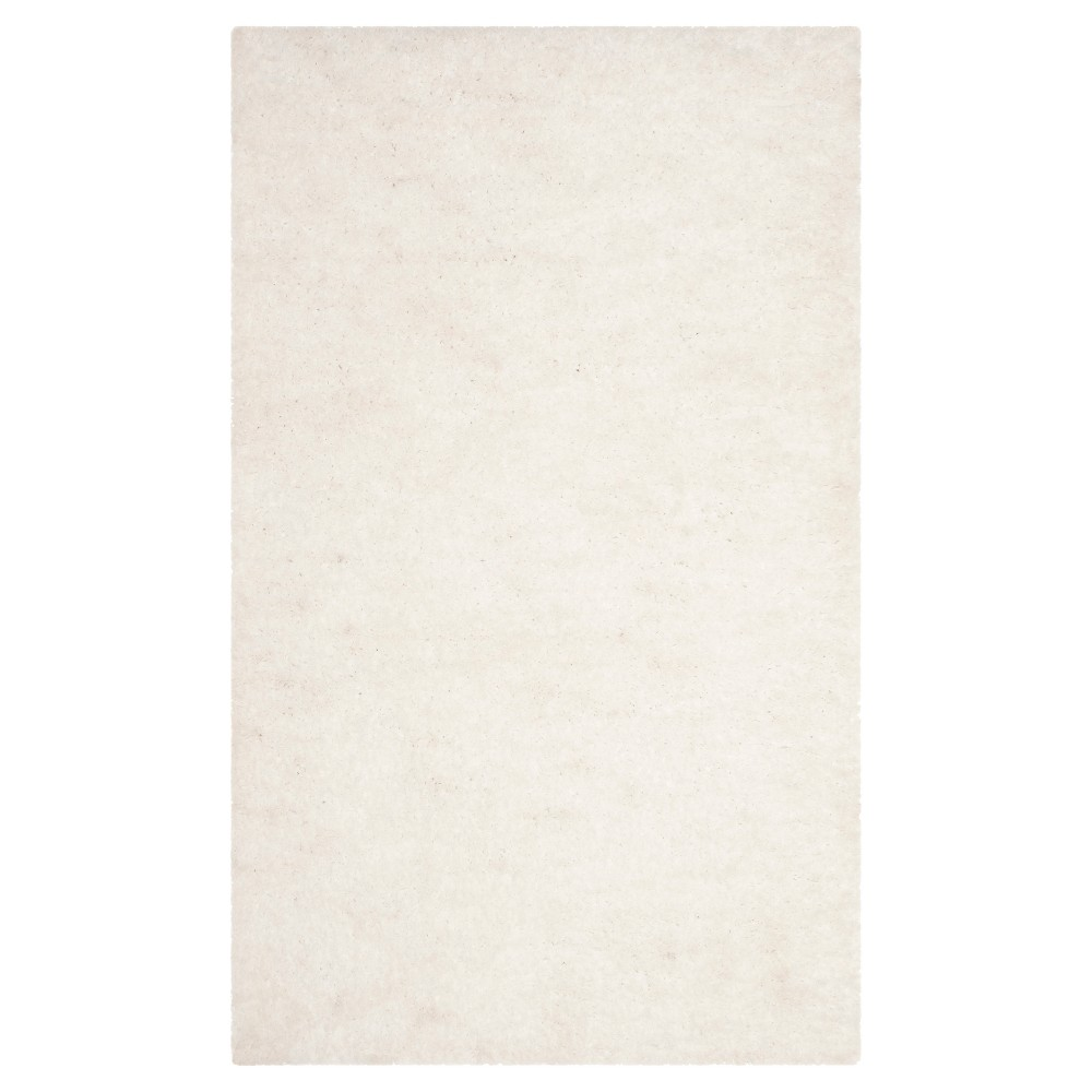 Ivory Solid Tufted Accent Rug - (3'x5') - Safavieh