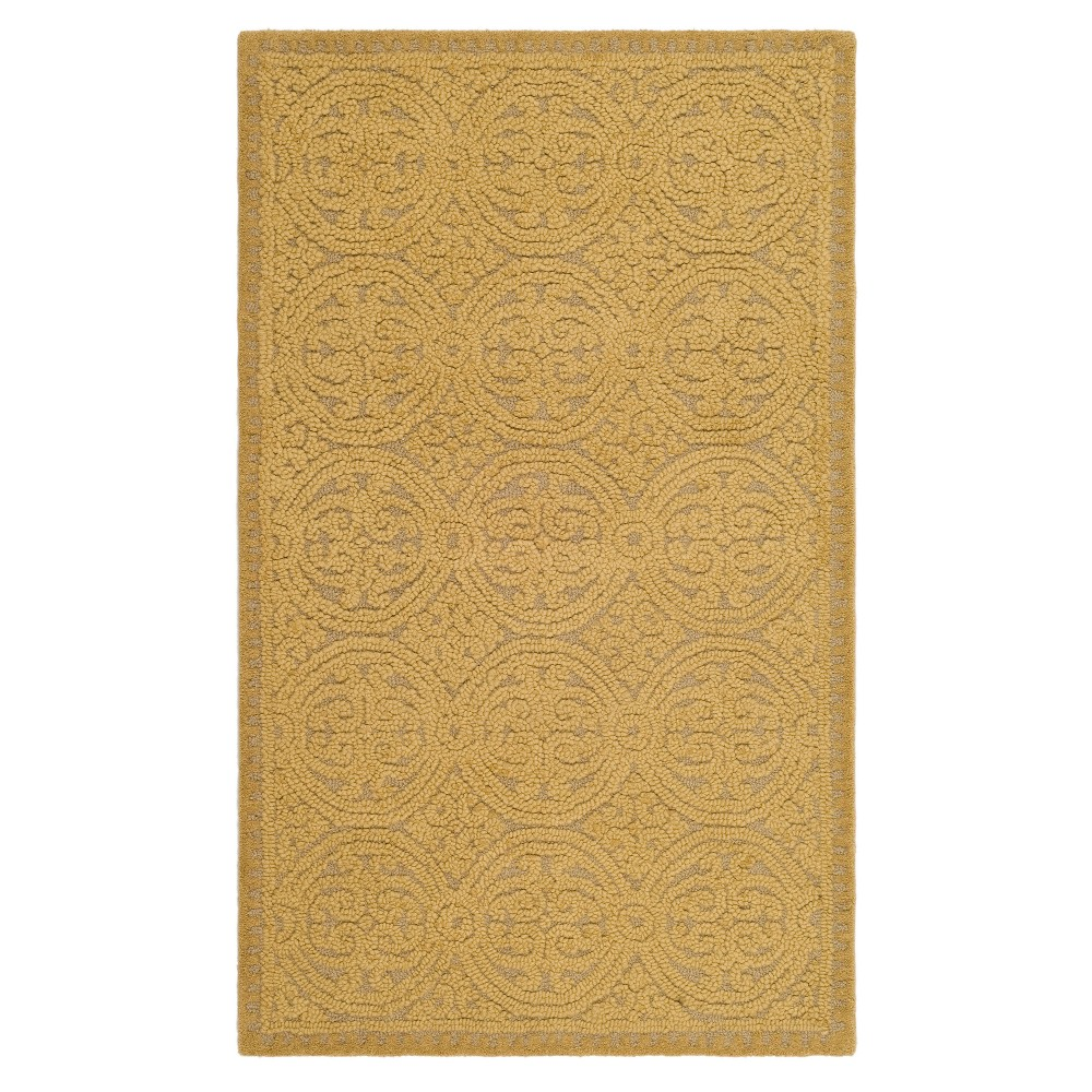 Navy Medallion Tufted Accent Rug 3'X5' - Safavieh, Gold