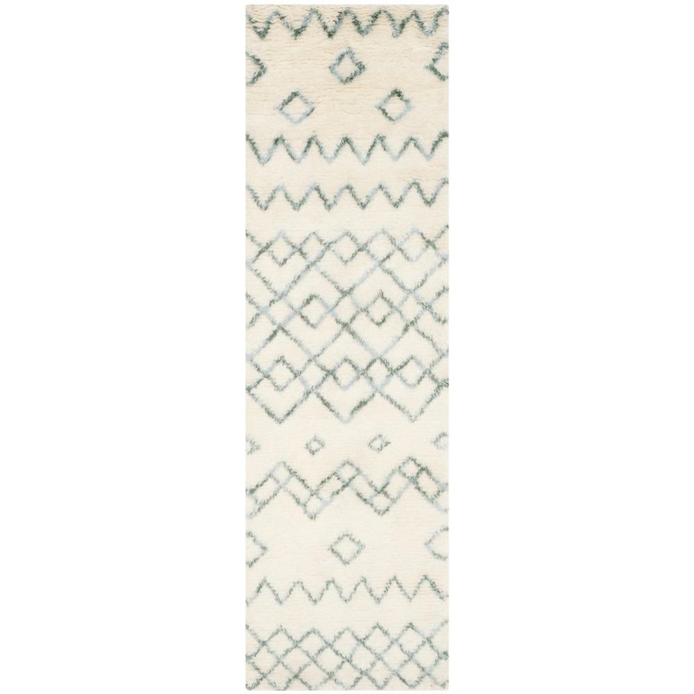 2'3X12' Tribal Design Tufted Runner Rug Ivory/Blue - Safavieh