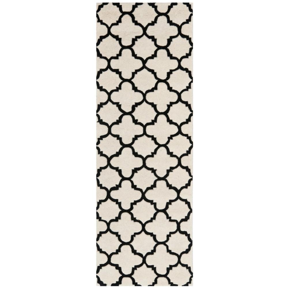 23X11 Quatrefoil Design Tufted Runner Rug Ivory/Black - Safavieh Price