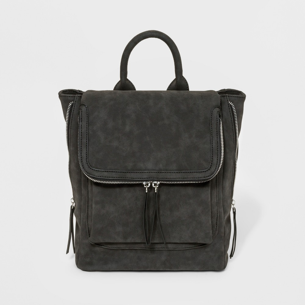 VR By Violet Ray Zippered Backpack - Black This Zippered Mini Backpack from Violet Ray is a must-have addition to your daily bag arsenal. Made with a material that creates the appearance of faux-suede in a deep black color, this mini fashion backpack has silver zipper and metal accents, along with simple zipper pulls for easy access. With several exterior and interior pockets to help keep you organized, and adjustable shoulder straps to help you get just the right fit, this faux-suede backpack is a must-have to meet all your day-to-day carrying needs. Gender: Female. Pattern: Solid.