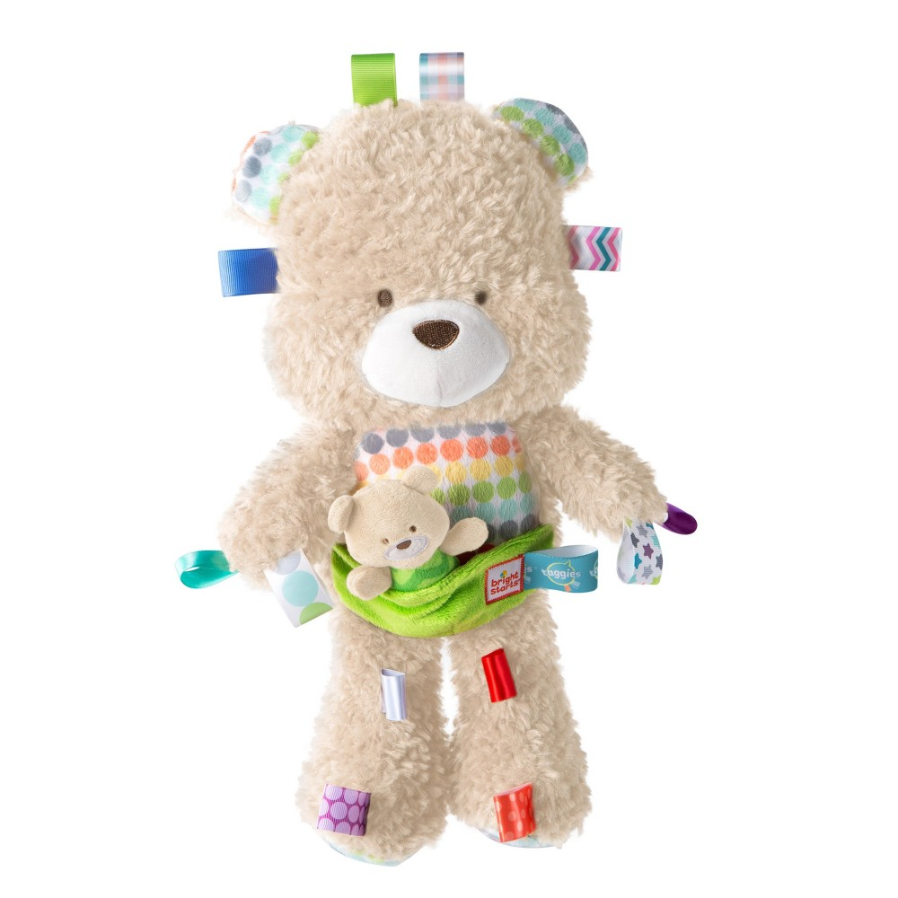 """Bright Starts Snuggle & Play Taggies Bear Fun Comes First! The super soft fabrics and enchanting features of the Snuggle and Play Bear from Bright Starts Taggies makes this teddy bear """"un-bearable"""" to put down. Baby will love cuddling up to the premium soft fabrics and getting their hands on the irresistible silky and colorful Taggies tags to engage baby's fingers. Introduce baby to put-and-take play with the baby bear buddy. A sweet, soft chime inside teddy bear sounds with a gentle shake. Perfect for babies newborn and up."""