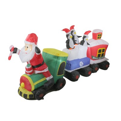 Northlight 6.5' Red and Green Inflatable Santa and Penguins on Train Lighted Outdoor Christmas Decoration