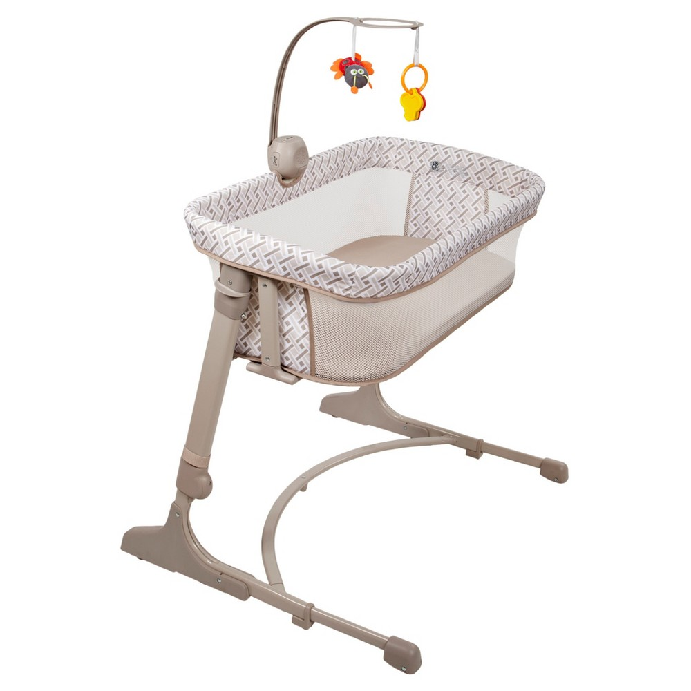 Arm's Reach Co-Sleeper Versatile Bassinet - Woven Tan Designed to accommodate all types (platform style or traditional) and heights of beds with it's adjustable height mechanism; to keep your baby close and safe. Meets Astm F2194 standard and Jpma certified. You can enjoy the sleeping nest resting on top of the mattress or alongside your bed for ease of breastfeeding, bonding and nighttime comforting. The new Versatile bedside bassinet was manufactured within Arm's Reach's core principles of providing quality bassinets, which exceed safety standards while promoting bedside parent-infant bonding. The Versatile features a Music Box and Mobile: Music Box plays five tunes, three nature sounds, one ocean sound and one mothers womb sound. Mobile includes plush hanging toy and color rings. Color: Woven Tan. Gender: Unisex.