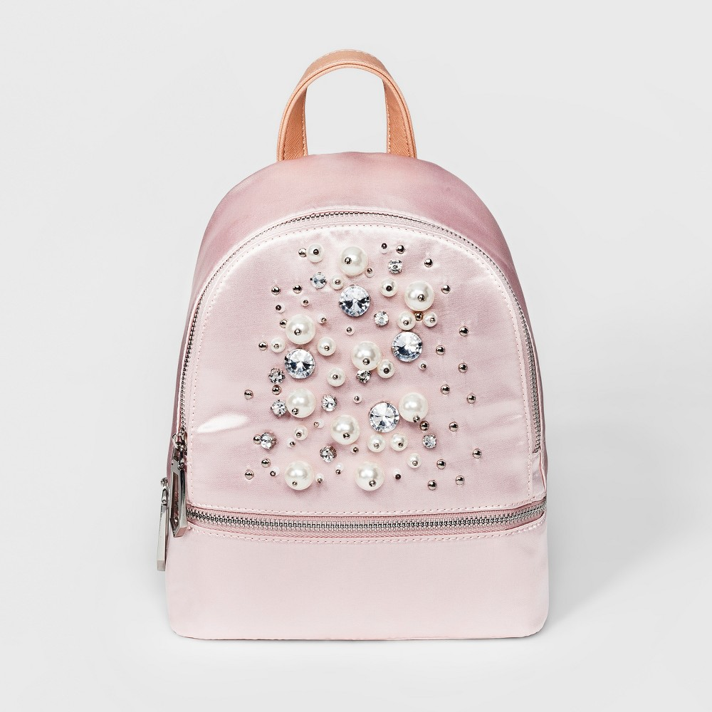 Women's Under One Sky The Pearl Backpack - Blush Turn your carry-on or everyday bag into a fashion statement with the Pearl Backpack from Under One Sky. Featuring a sleek material, this fashion backpack with beading can hold more than a regular handbag and eases the weight of carrying your items on only one shoulder. The studded backpack includes one large zippered compartment with interior pocket for valuables, plus a smaller zippered compartment in front. Color: Blush. Gender: Female. Pattern: Solid.