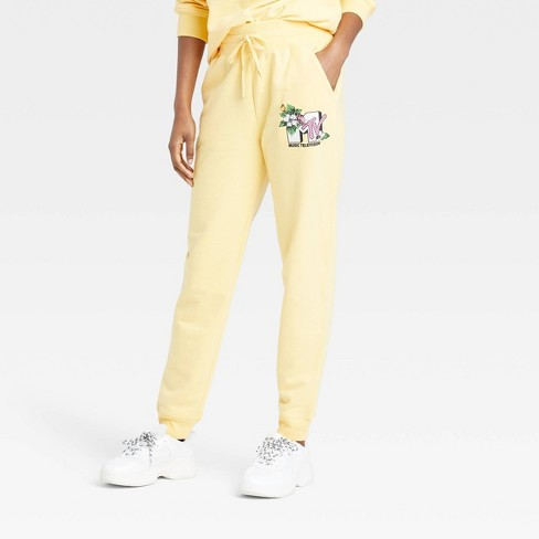 Women's MTV Floral Print Logo Graphic Jogger Pants - Yellow - image 1 of 2