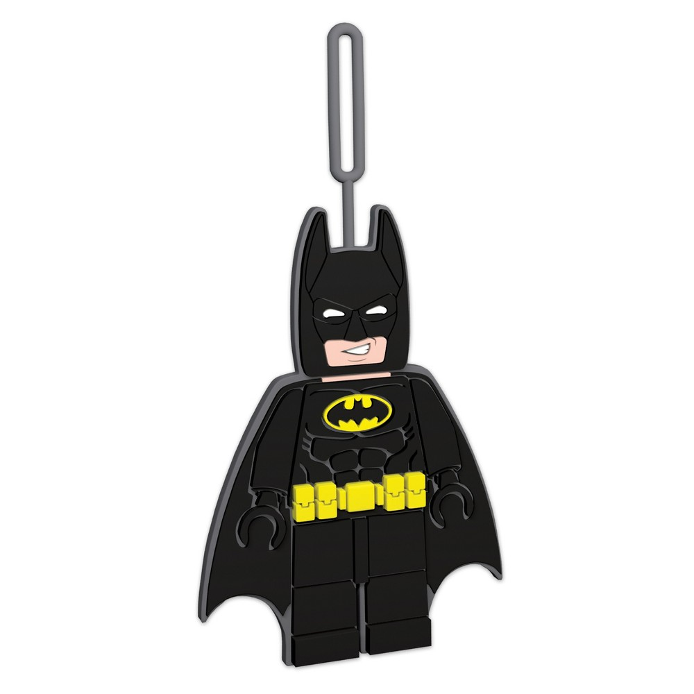 Lego Batman Luggage Tag, Multi-Colored Take a superhero with you everywhere you go with the Lego Batman minifigure shaped silicone luggage/ID tag from The Lego Batman Movie. Easy to use loop, attaches to luggage and backpacks. Space on back for writing contact information. Minifigure height approximately 5.3 inches. Silicone luggage tag. Color: Multi-Colored. Gender: Unisex. Age Group: Adult. Pattern: Solid.