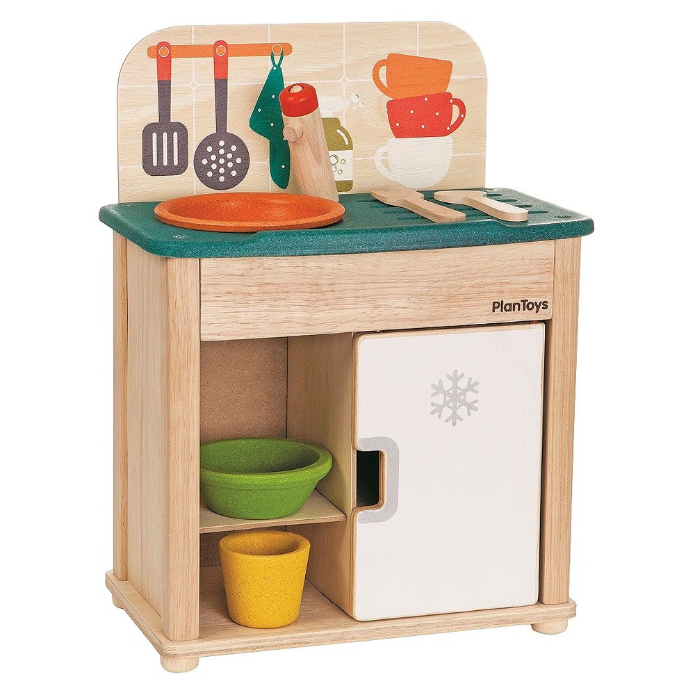 PlanToys Sink And Fridge, Cooking and Dining Toys The PlanToys Sink and Fridge is the perfect size for your little toddler. This kids kitchen includes 1 bowl, 1 cup, 1 plate, and 2 utensils. With a portable design, it can be used on the floor, a table or even a shelf. Your kids will love making food and playing the chef with this play kitchen. For ages 2 and up. Gender: Female.